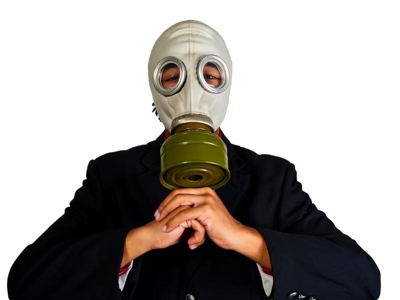 Businessman wearing gas mask