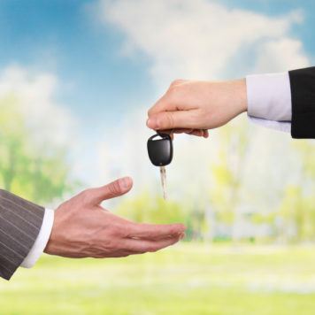 handing car keys to new owner
