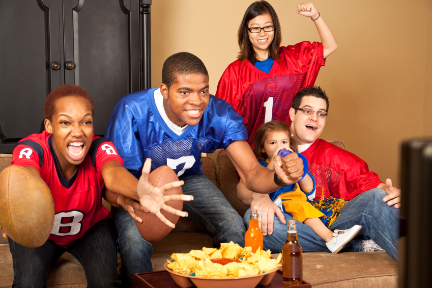 friends watching football game on tv