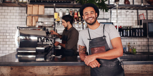 coffe shop worker smiling to camera