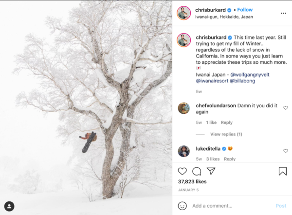 Best Travel Instagrams - Snowy image of Chris Burkard on a snowboard jumping out of a frost covered tree
