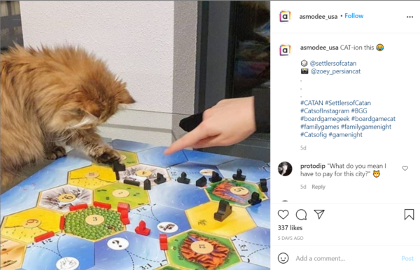 """Get people talking with board game marketing that uses posts like this one that has an image of a cat moving a playing piece and text saying """"CAT-ion this"""""""