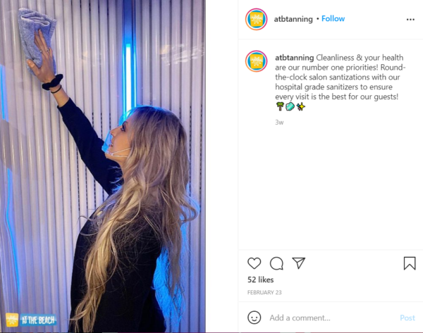 ATB Instagram post featuring an employee cleaning a vertical tanning booth
