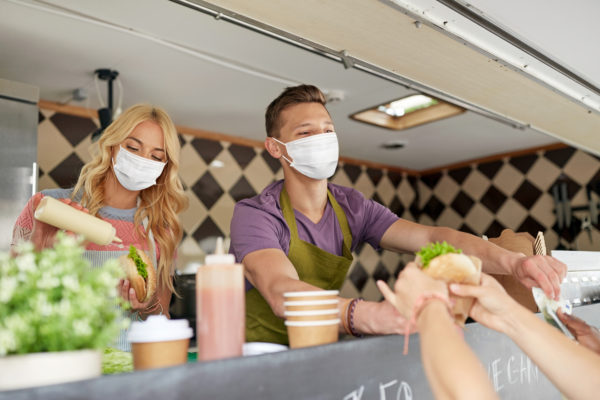 A masked crew working a food truck
