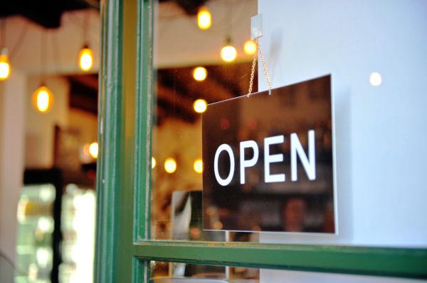 keep your doors open regardless of retail sales seasonality -- retail open sign on glass door framed in green