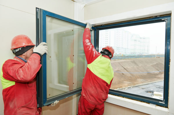 how to start a window installation business - tow installers working on a large window