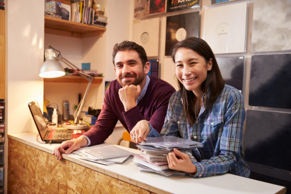 types of businesses - partnership, two people owning and running a record shop together.