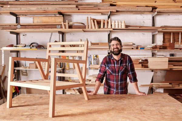 types of businesses - this furniture maker is a solopreneur but he can choose from several different business structures