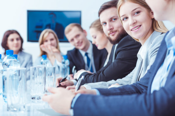 types of businesses -- people in business attire attending a stockholders meeting