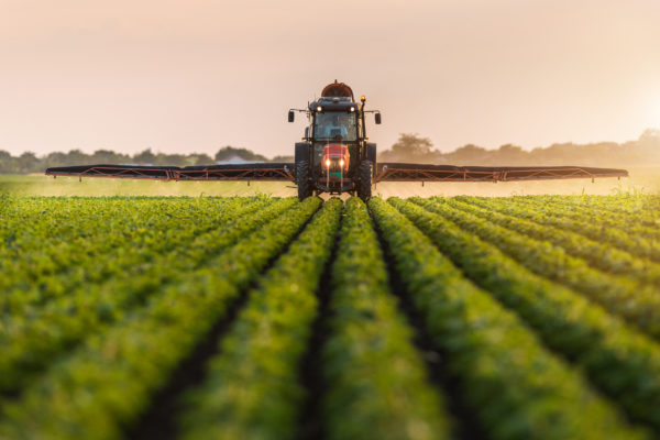 Types of businesses - large tractor spraying crops