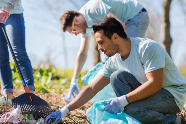 How to Get Clients For Private Duty Home Care -- Volunteer -- Volunteers cleaning up trash in a park