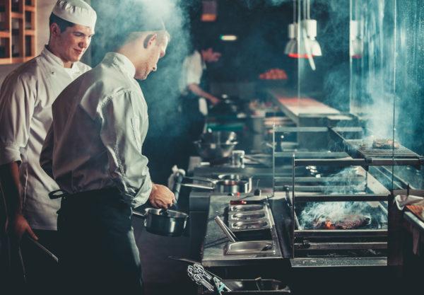 chefs preparing beef